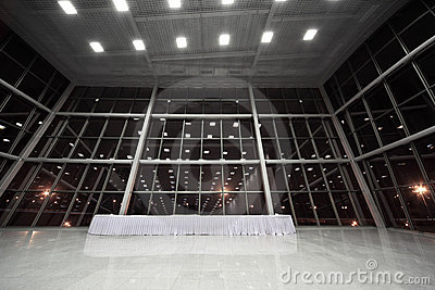 Table covered with white tablecloth in lobby