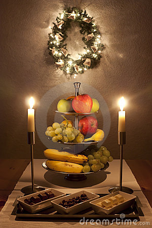 Table with fruits and sweets at christmas