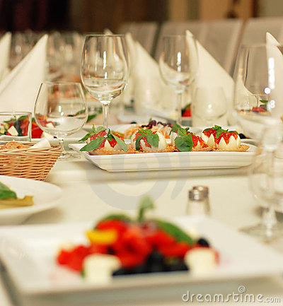 Free Table In Restaurant With Food And Wine Glasses Stock Photos - 4736643