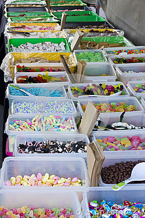 Table with many different types of candy