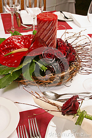 Table with Red roses and candle