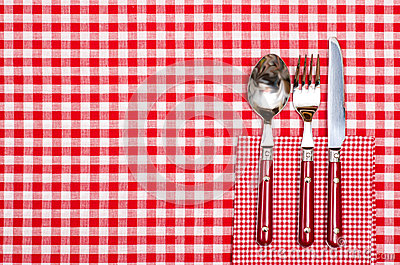Table in a restaurant with cutlery in red