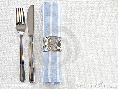 Table setting with blue an white striped napkin