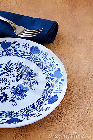 Table setting a plate with a blue pattern