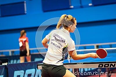 Table tennis game between girls