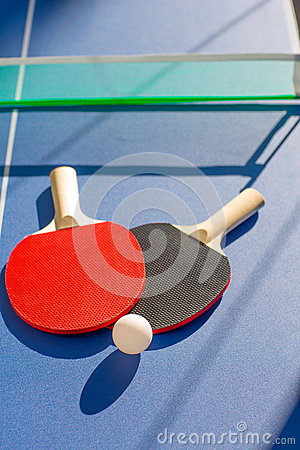 Table tennis ping pong two paddles and white ball