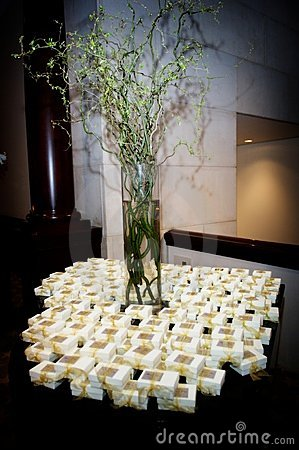 Table topped with wedding favors