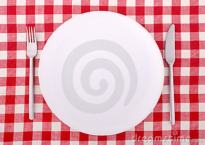 Tablecloth with fork, knife and an empty plate