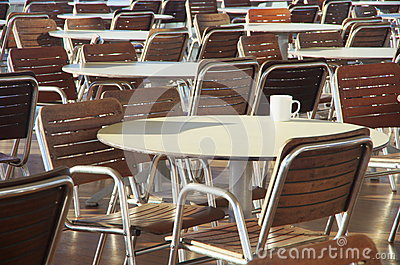 Tables, chairs and a coffee cup