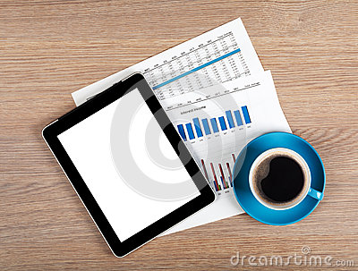 Tablet with blank screen and coffee cup