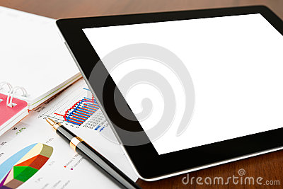 Tablet computer on a businessman workplace