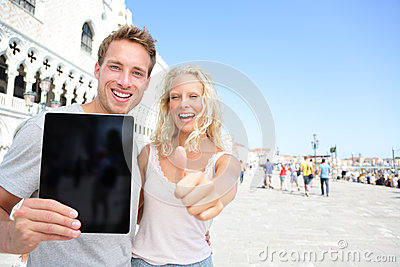 Tablet computer couple on travel in Venice
