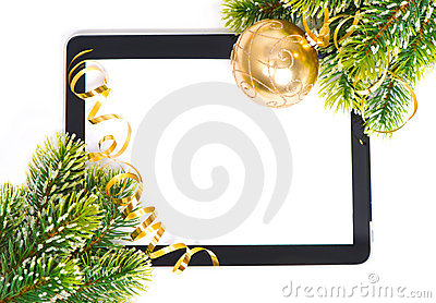 Tablet pc and golden ball and christmas tree