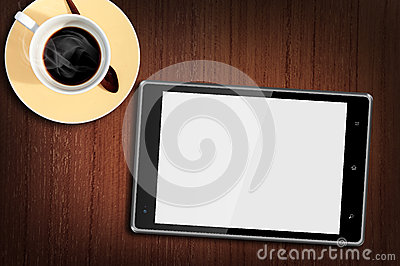 Tablet pc on Wood Table with a cup of coffee