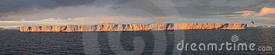 Tabular iceberg, sunset glow