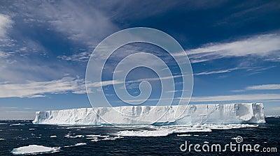 Tabular Iceberg Under Sunny, Blue Skies