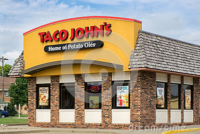 Taco john 39 s exterior and sign editorial stock image for Mcdonalds exterior design
