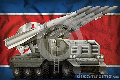 Tactical short range ballistic missile with city camouflage on the Democratic Peoples Republic of Korea North Korea national fla Stock Photo