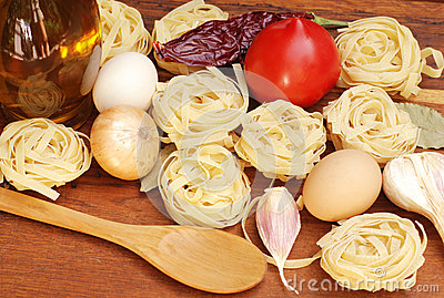 Tagliatelle pasta ingredients on wooden board