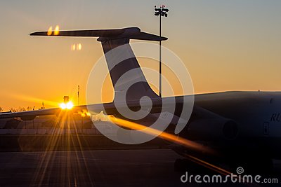 The tail of the aircraft on the background of the rising sun Stock Photo