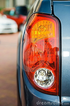 Tail lights of a blue truck