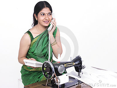 Tailor speaking on her phone