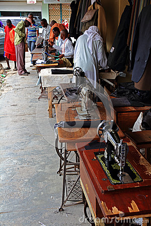 Tailors and Sewing Machines on an African Street Editorial Image