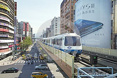 Taipei Metro Brown Line Train approaches Station Editorial Image