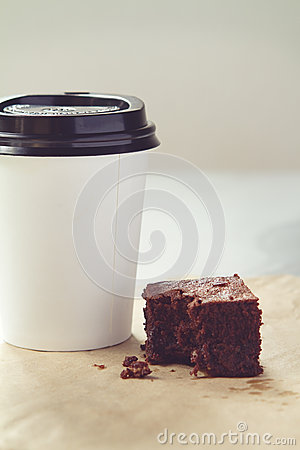 Free Take Away Coffee Cup And Chocolate Brownie In Muted Tones Stock Photos - 51515313