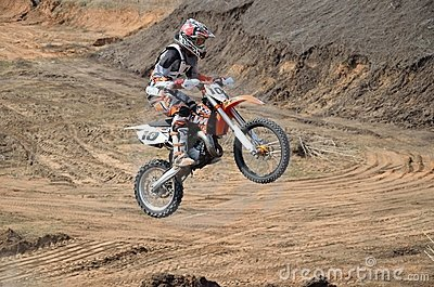 Take off on big hill on a motorbike motocross Editorial Stock Photo
