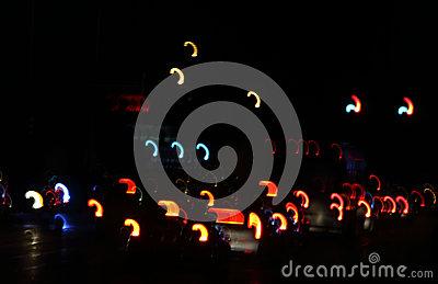 Abstract:  Taillights at night