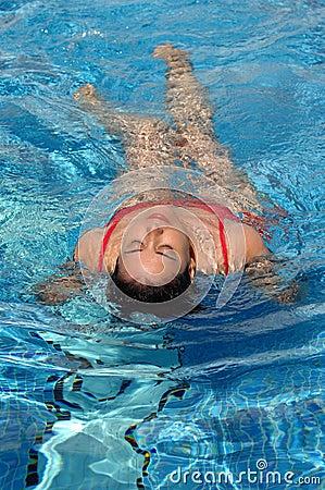 Taking bath on a swimming pool