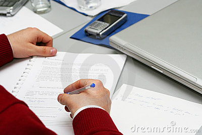 Taking notes on the meeting at boardroom