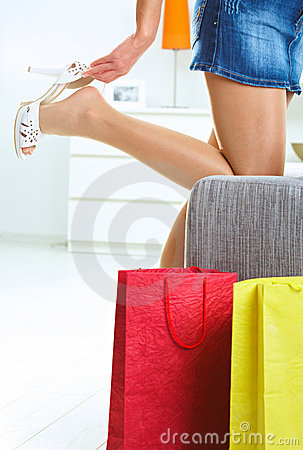 Free Taking Off Shoe After Shopping Stock Photography - 10629512