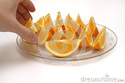Taking orange slices