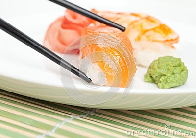 Taking sushi from the white plate