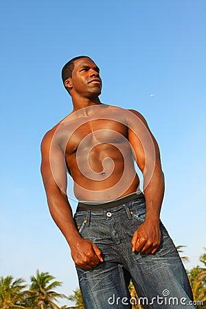 Tall Bodybuilder Flexing Muscles