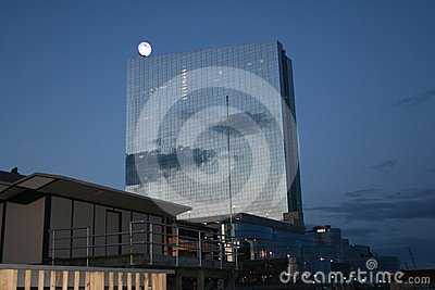Tall building moon at evening