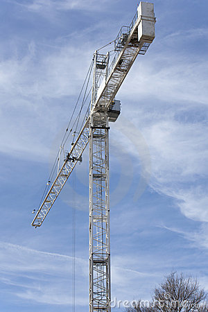 Tall construction crane with blue sky