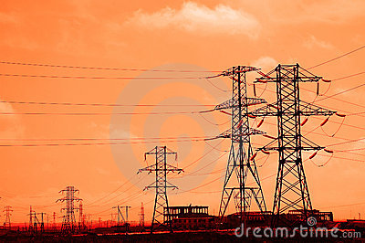 Tall power lines during sunset
