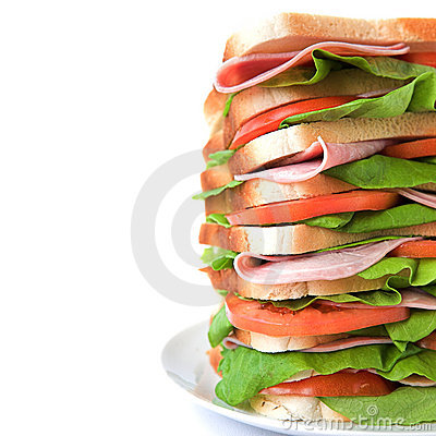 Tall sandwich of ham, tomato & lettuce