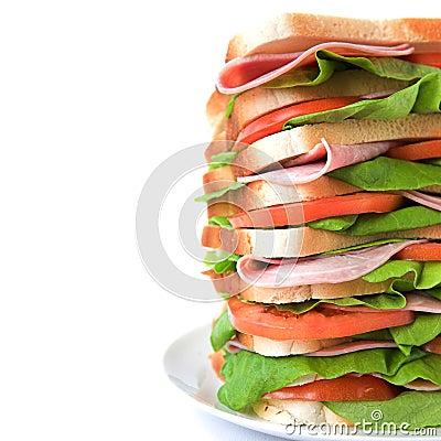 Tall sandwich of ham, tomato & lettuce