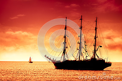 Tall ship sailing in red