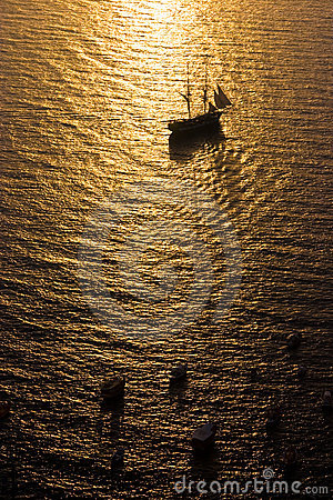 Tall Ship Sailing into Sunset