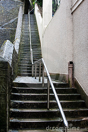 Free Tall Slippery Wet Stone Steps With Steel Rail Royalty Free Stock Photo - 16488725