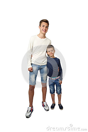 Free Tall Teenager And Little Boy Stand Together Embracing Royalty Free Stock Photography - 78694427