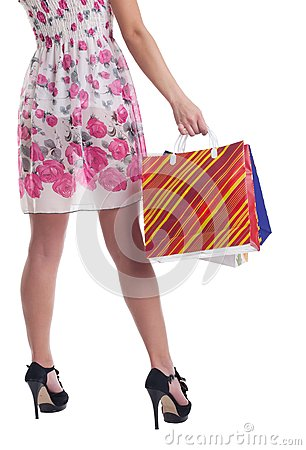 Tall woman legs with stiped shopping bags