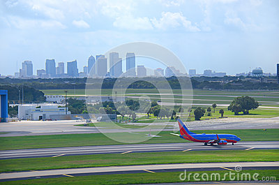 Tampa skyline with plane at Tampa Intl Airport