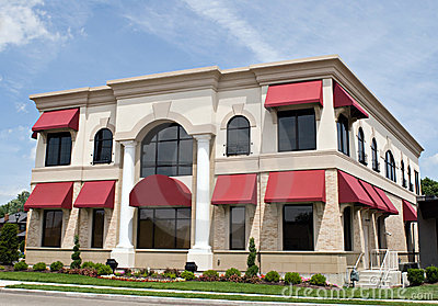 Tan Building with Red Awnings