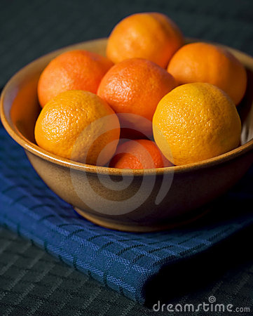 Tangerines In Bowl on Blue Placemat